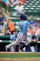 Tampa Bay Rays right fielder Guillermo Heredia (54) follows through on a swing during a Grapefruit League Spring Training game against the Baltimore Orioles on March 1, 2019 at Ed Smith Stadium in Sarasota, Florida.  Rays defeated the Orioles 10-5.  (Mike Janes/Four Seam Images)
