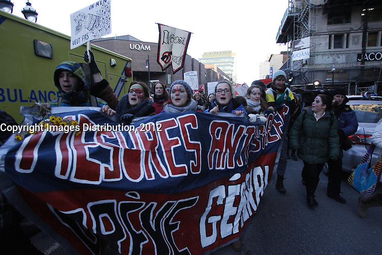 Montreal (QC) CANADA - February 20 2012 - Quebec students on strike againt tuition fees increase, walk in the street of downtown Montreal causing traffic jam