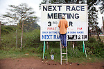 A sign painter at work updating the sign post for The Kenya Derby at Ngong Racecourse in Nairobi, Kenya. The annual Derby is Kenya's biggest horse race of the year.