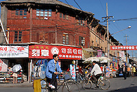 The old shopping district of Kunming, the capital of Yunnan Province, China. The area of traditional Chinese houses and shops is being restored as most of the rest of the old city has been destroyed during a building boom of the last ten years..28 Nov 2006