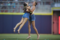 Two fans compete in a contest where they have to pop balloons between innings of the game between the Charleston RiverDogs and the Kannapolis Cannon Ballers at Atrium Health Ballpark on July 1, 2021 in Kannapolis, North Carolina. (Brian Westerholt/Four Seam Images)