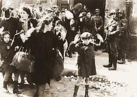 """1943/04/19 - 1943/05/16 - Photo from J¸rgen Stroop Report to Heinrich Himmler from May 1943. The original German caption reads: """"Forcibly pulled out of dug-outs"""". One of the most famous pictures of World War II. People recognized in the picture:<br /> <br />     * Boy in the front was not recognized, some possible identities: Artur Dab Siemiatek, Levi Zelinwarger (next to his mother Chana Zelinwarger) and Tsvi Nussbaum.<br />     * Hanka Lamet - small girl on the left<br />     * Matylda Lamet Goldfinger - Hanka's mother next to her (second from the left)<br />     * Leo Kartuzinski - far back with white bag on his shoulder<br />     * Golda Stavarowski - also in the back, first women from the right, with one hand raised<br />     * Josef Blˆsche - SS man with the gun<br /> <br /> <br /> Deutsch: Aufstand im Warschauer Ghetto ñ Fotografie von J¸rgen Stroop. Aus dem Stroop-Bericht von 1943 an Heinrich Himmler von Mai 1943. Die originale Bildunterschrift lautet ÑMit Gewalt aus Bunkern hervorgeholtì. Es ist eines der bekanntesten Fotos aus dem zweiten Weltkrieg. Auf dem Foto identifizierte Personen:<br /> <br />     * Der Junge im Vordergrund wurde nicht zweifelsfrei wiedererkannt, mˆgliche Identit‰ten: Artur Dab Siemiatek, Levi Zelinwarger (neben seiner Mutter Chana Zelinwarger) oder Tsvi Nussbaum.<br />     * Hanka Lamet ñ kleines M‰dchen links.<br />     * Matylda Lamet Goldfinger ñ Hankas Mutter daneben, 2. von links.<br />     * Leo Kartuzinski ñ Jugendlicher im Hintergrund mit weiflem Sack auf der Schulter.<br />     * Golda Stavarowski ñ im Hintergrund, erste Frau von rechts mit einer erhobenen Hand.<br />     * Josef Blˆsche ñ SS-Mann mit Gewehr, wurde 1969 hingerichtet.<br /> <br /> <br /> FranÁais : Insurrection du Ghetto de Varsovie. Photo extraite du rapport de mai 1943 de J¸rgen Stroop ‡ Heinrich Himmler. LÈgende originale en allemand : ´ ForcÈs hors de leurs trous ª. Cette photo est l'une des plus cÈlËbres de la Seconde Guerre mondiale. Certaines des pers"""