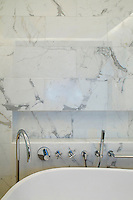 Modern bathroom with marble wall