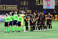 ATLANTA, GA - APRIL 24: Referees and Atlanta United starters during National Anthem before the match between Chicago Fire FC and Atlanta United FC at Mercedes-Benz Stadium on April 24, 2021 in Atlanta, Georgia.