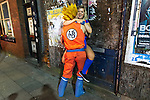 © Joel Goodman - 07973 332324 . 27/12/2016 . Wigan , UK . A couple wearing Dragon Ball Z themed outfits . Revellers in Wigan enjoy Boxing Day drinks and clubbing in Wigan Wallgate . In recent years a tradition has been established in which people go out wearing fancy-dress costumes on Boxing Day night . Photo credit : Joel Goodman