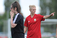 Sophie Ingle of Wales Women interacts with Wales Homeless squad and school children during the Wales Women post training session at the Cardiff International Sports Stadium in Cardiff, Wales, UK. Monday 03 June 2019