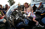 Lori Geiger watches her granddaughter Tatum Geiger, 1, check out a Nevada Highway Patrol motorcycle during the 11th annual National Night Out hosted by the Carson City Sheriff's Office in Carson City, Nev., on Tuesday, Aug. 6, 2013. <br /> Photo by Cathleen Allison