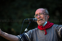 """Giuliano Giuliani, Father of Carlo Giuliani.<br /> <br /> Memoria è Lotta (Memory is Struggle); Per Non DimentiCarlo (To Not Forget Carlo).<br /> <br /> Presidio in Piazza Alimonda, Rally in Piazza Alimonda (AKA Piazza Carlo Giuliani, Ragazzo) where at 17:27 of the 20th July 2001 the 23-year-old-demonstrator Carlo Giuliani - who was carrying over his head a fire extinguisher - was killed by firearm bullets shot by the 20-year-old Carabinieri's (police) officer Mario Placanica and then run over twice by a Carabinieri's Land Rover.<br /> <br /> Genoa, Italy. 19, 20, 21 July 2021. Twenty years after the dramatic and terrifying events related to the 2001 Genoa's G8 meeting, according to Amnesty International: """"the most serious suspension of democratic rights in a Western country since the Second World War"""" (1.) and as stated on the 2001 """"Report on the situation of fundamental rights in the EU"""" the European Parliament """"deplores the suspensions of fundamental rights that took place during public demos, and in particular at the G8 meeting in Genoa, such as freedom of expression, freedom of movement, the right to physical integrity"""" (2.). As a reminder, the City of Genoa is State Gold Medal (Medaglia D'Oro) for its Antifascist Resistance in World War II.<br /> Some photos, part of this story, are presented appositely in Black & White to show to the audience """"the Places"""" where the majority of - the already mentioned (see above) - """"suspensions of fundamental rights […] such as freedom of expression, freedom of movement, the right to physical integrity"""" (2.) happened.<br /> ...<br /> <br /> FULL CAPTION & LINKS AT THE BEGINNING OF THIS STORY.<br /> <br /> Footnotes, Links:<br /> <br /> 1. http://bit.do/fRvdg<br /> 2. http://bit.do/fRvdi<br /> <br /> http://www.veritagiustizia.it/doc_eng/<br /> https://www.carlogiuliani.it<br /> https://en.wikipedia.org/wiki/Death_of_Carlo_Giuliani<br /> The bloody battle of Genoa (Source, The Guardian, 2008): http://bit.do/fRvB2"""