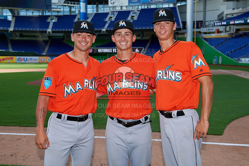 Miami Marlins Will Banfield (22), coach Nathan Mikolas (28) and Connor Scott (24) after a Florida Instructional League game against the Washington Nationals on September 26, 2018 at the Marlins Park in Miami, Florida.  (Mike Janes/Four Seam Images)