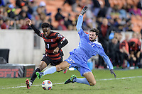 Houston, TX -  Friday, December 9, 2016: Walker Hume (37) of the North Carolina Tar Heels slides in to strip the ball from Bryce Marion (7) of the Stanford Cardinal  at the  NCAA Men's Soccer Semifinals at BBVA Compass Stadium.