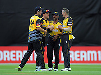 From left, Jamie Gibson, Logan van Beek, Jeetan Patel and Ollie Newton celebrate a wicket during the Dream11 Super Smash T20 cricket match between the Wellington Firebirds and Central Stags at Basin Reserve in Wellington, New Zealand on Thursday, 18 December 2019. Photo: Dave Lintott / lintottphoto.co.nz