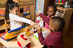 Education Preschool 3-4 year olds pretend play group of two girls and a boy playing game with turn taking and rules