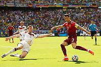 Cristiano Ronaldo of Portugal and Per Mertesacker of Germany