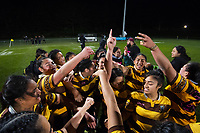 The Porirua team huddle at halftime during the 2019 Wellington secondary schools girls 1st XV rugby final between Porirua/Aotea College (combined) and Hutt Valley High School at Porirua Park in Wellington, New Zealand on Wednesday, 21 August 2019. Photo: Dave Lintott / lintottphoto.co.nz