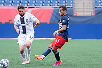 FOXBOROUGH, MA - JULY 4: Colby Quinones #41 of the New England Revolution II passes the ball as Jacob Goodall #11 of Greenville Triumph SC pressures during a game between Greenville Triumph SC and New England Revolution II at Gillette Stadium on July 4, 2021 in Foxborough, Massachusetts.