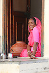 A woman takes a break from her household duties in Udaipur.