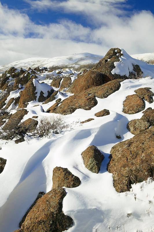 Rock outcrop and snow. Hart Mountain National Antelope Refuge, Oregon