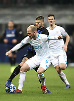 Football: UEFA Champions League -Group Stage - Group B - FC Internazionale Milano vs PSV Eindhoven, Giuseppe Meazza  (San Siro) Stadium, Milan Italy, December 11, 2018.<br /> Inter Milan's Captain Mauro Icardi (l) in action with PSV Eindhoven's Jorrit Hendrix (r) during the Uefa Champions League football match between Inter Milan and PSV Eindhoven at Giuseppe Meazza  (San Siro) Stadium in Milan on December 11, 2018. <br /> UPDATE IMAGES PRESS/Isabella Bonotto