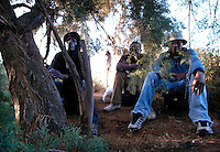 George, Tupah and Issa, three migrants hiding in the bushes on a garbage dump outside Nador, waiting to be picked up by the Moroccan traffickers who will smuggle them to secret beaches from where they will board the inflatable boats for crossing to Spain.