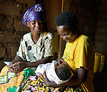 Community Health Worker Marie Chantal monitors a mom nursing her three-week old newborn in Batamuliza Hururiro village, near Rukumo Health Center, Rwanda....