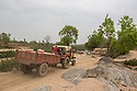 India - Jharkhand - Karari - A truck full of mica leaves the village of Karari. Agents collect mica one a week from the villagers and bring it illegaly to JJhumri Tilaiya's factories, 30-km-away.
