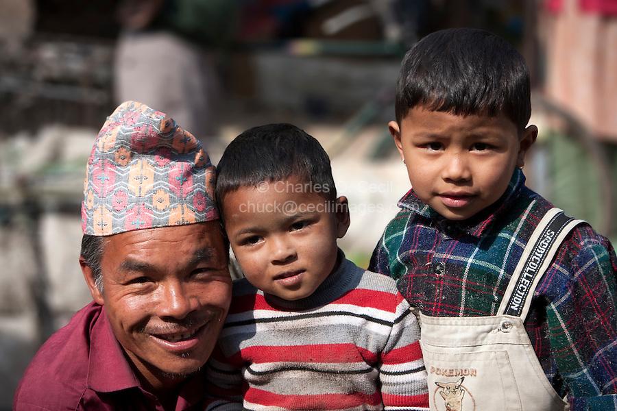 Nepal, Kathmandu.  Father and Two Sons.