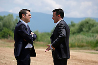 Pictured: (L-R) Greek Prime Minister Alexis Tsipras with his counterpart Zoran Zaevat at Prespa Lake in northern Greece. Sunday 17 June 2018<br /> Re: Greece and the Former Yugoslav Republic Of Macedonia (FYROM) have signed a deal that aims to settle a decades-long dispute over the country's name.<br /> Under the agreement, Greece's neighbour will be known as North Macedonia.<br /> Heated rows over Macedonia's name have been going on since the break-up of the former Yugoslavia, of which it was a part, and have held up Macedonia's entry to Nato and the EU.<br /> Greece has long argued that by using the name Macedonia, its neighbour was implying it had a claim on the northern Greek province also called Macedonia.<br /> The two countries' leaders, Mr Tsipras and his Macedonian counterpart Zoran Zaev announced the deal on Tuesday and have pressed ahead despite protests.<br /> The two countries' foreign ministers signed the deal on Lake Prespa on Greece's northern border on Sunday.<br /> The agreement still needs to be approved by both parliaments and by a referendum in Macedonia.