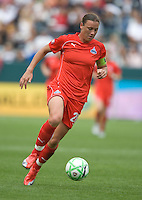 Abby Wambach (20) dribbles the ball against the LA Sol during the WPS season opening game at the Home Depot Center, Sunday, March 29, 2009. The LA Sol won 2-0.
