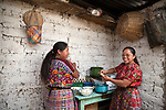 Portrait of Gloria Marina Icu Puluc and her mother Juanita, from the Asociación Civil de Comadronas Tradicionales de Chimaltenango (ACOTCHI) in San Juan Comalapa, Guatemala.
