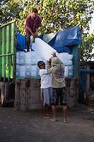 Bali, Indonesia.  Off-loading Ice to go to Fishing Boats, Jimbaran Fish Market.