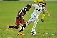 WASHINGTON, DC - SEPTEMBER 27: Moses Nyeman #27 of D.C. United battles for the ball with Tommy McNamara #26 of New England Revolution during a game between New England Revolution and D.C. United at Audi Field on September 27, 2020 in Washington, DC.