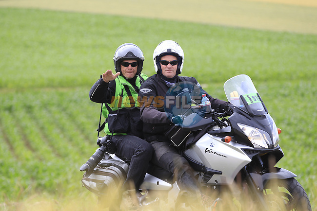Moto photographers ahead of the race pass through rural landscape near Bemont during Stage 4 of the 2014 Tour de France running 163.5km from Le Touquet to Lille. 8th July 2014.<br /> Picture: Eoin Clarke www.newsfile.ie