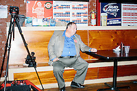 A man sits on a bench after Texas senator and Republican presidential candidate Ted Cruz spoke to a crowd at a business round-table at the Draft Sports Bar and Grille in Concord, New Hampshire.
