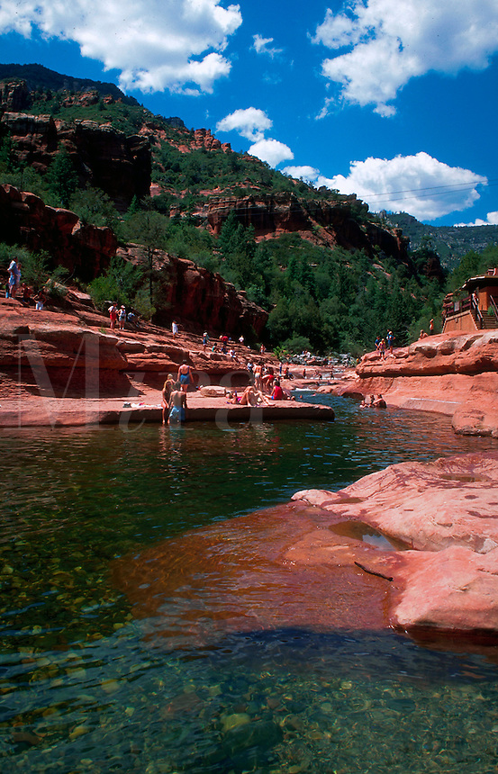 People relaxing on the rocks and in the water at Slide Rock State Park. Sedona, Arizona.