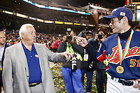 Former manager of the Los Angeles Dodgers, Tommy Lasorda, visit's with Ichiro Suzuki of Japan during World Baseball Championship at Petco Park in San Diego,California on March 20, 2006. Photo by Larry Goren/Four Seam Images