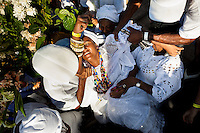A Candomblé follower becomes possessed during the ritual ceremony in honor to Yemanjá, the goddess of the sea, in Cachoeira, Bahia, Brazil, 5 February 2012. Yemanjá, originally from the ancient Yoruba mythology, is one of the most popular ?orixás?, the deities from the Afro-Brazilian religion of Candomblé. Every year on February 5th, hundreds of Yemanjá devotees participate in a colorful celebration in her honor. Faithful, usually dressed in the traditional white, gather on the banks of Paraguaçu river to leave offerings for their goddess. Gifts for Yemanjá include flowers, perfumes or jewelry. Dancing in the circle and singing ancestral Yoruba prayers, sometimes the followers enter into a trance and become possessed by the spirits. Although Yemanjá is widely worshipped throughout Latin America, including south of Brazil, Uruguay, Cuba or Haiti, the most popular cult is maintained in Bahia, Brazil.