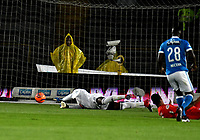 BOGOTA - COLOMBIA - 11 - 03 - 2017: Duvier Riascos (Der.), jugador de Millonarios, anota gol a Carlos Bejarano (Izq.), portero de America, durante partido de la fecha 9 entre Millonarios y America de Cali, por la Liga Aguila I-2017, jugado en el estadio Nemesio Camacho El Campin de la ciudad de Bogota. / Duvier Riascos (R) player of Millonarios scored a goal to Carlos Bejarano (L), goalkeeper of America, during a match between Millonarios and America de Cali, of the date 9 for the Liga Aguila I-2017 played at the Nemesio Camacho El Campin Stadium in Bogota city, Photo: VizzorImage / Luis Ramirez / Staff.