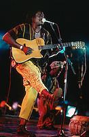 Mali. Bamako. The musician Habib Koite plays the guitar and sings during a concert at Mamadou Konate stadium. © 1997 Didier Ruef
