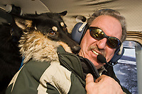 Close up of volunteer pilot Danny Davidson and dropped dog, *Cory,* on the flight back to McGrath on Thursday during the 2008 Iditarod