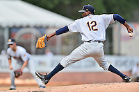 Charleston RiverDogs starting pitcher Domingo German (12) delivers a pitch during game one of a double header against the Asheville Tourists at McCormick Field on July 8, 2016 in Asheville, North Carolina. The RiverDogs defeated the Tourists 10-4 in game one. (Tony Farlow/Four Seam Images)
