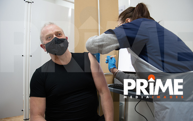 A  group 4 male patient receives his COVID-19 vaccination at Aspire Pharmacy, Hadlow Road, Sidcup, Kent, England on the 8 February 2021. Photo by Alan Stanford.