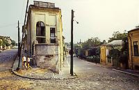 """ROMANIA, Bucharest, Uranus district, June 1983..Uranus district  before demolition. Ceausescu has planed to bulid the """"People House"""" on this oldest hill of the town..ROUAMNIE, Bucarest, quartier d'Uranus, juin 1983..Quartier d'Uranus avant démolition. Ceuasecu avait choisi de construire la """"Maison du Peuple"""" sur cette colline en rasant l'un des quartiers les plus anciens de la ville..© Andrei Pandele / EST&OST"""