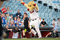 Nashville Sounds mascot Ozzie races a young fan during the first game of a double header against the Omaha Storm Chasers on May 21, 2014 at Herschel Greer Stadium in Nashville, Tennessee.  Nashville defeated Omaha 5-4.  (Mike Janes/Four Seam Images)