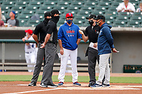 Tennessee Smokies manager Mark Johnson (8) takes part in the meeting at the plate prior to the game against the Biloxi Shuckers on May 18, 2021, at Smokies Stadium in Kodak, Tennessee. (Danny Parker/Four Seam Images)