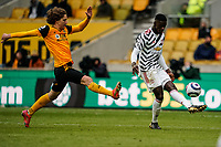 23rd May 2021; Molineux Stadium, Wolverhampton, West Midlands, England; English Premier League Football, Wolverhampton Wanderers versus Manchester United; Axel Tuanzebe of Manchester United clears the ball under the pressure from Fábio Silva of Wolverhampton Wanderers