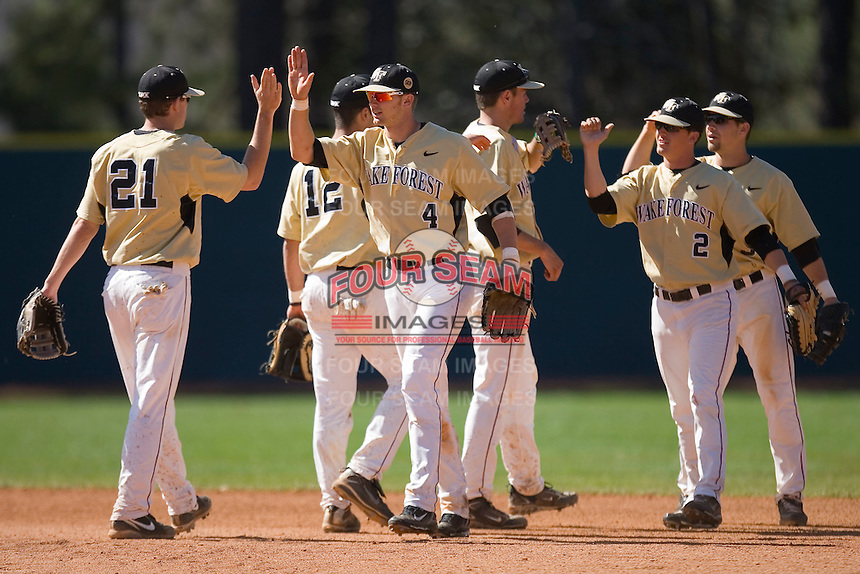 The Wake Forest Demon Deacons congratulate each other after defated the Duke Blue Devils 4-2 in game 1 of a double header at Jack Coombs Field March 29, 2009 in Durham, North Carolina. (Photo by Brian Westerholt / Four Seam Images)