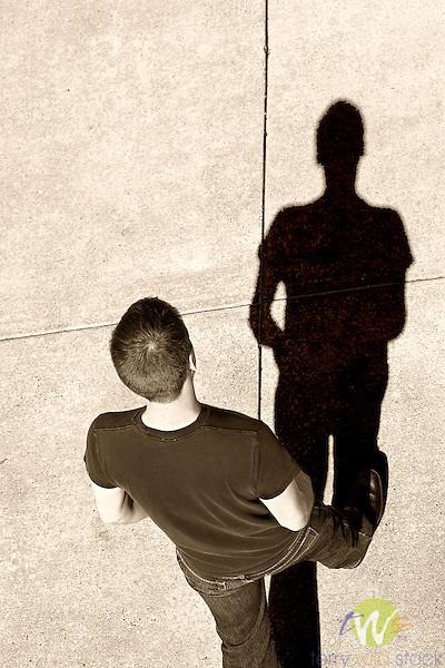 Man facing his shadow.