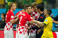 Croatia players complain to referee Yuichi Nishimura after he gives a penalty to Brazil