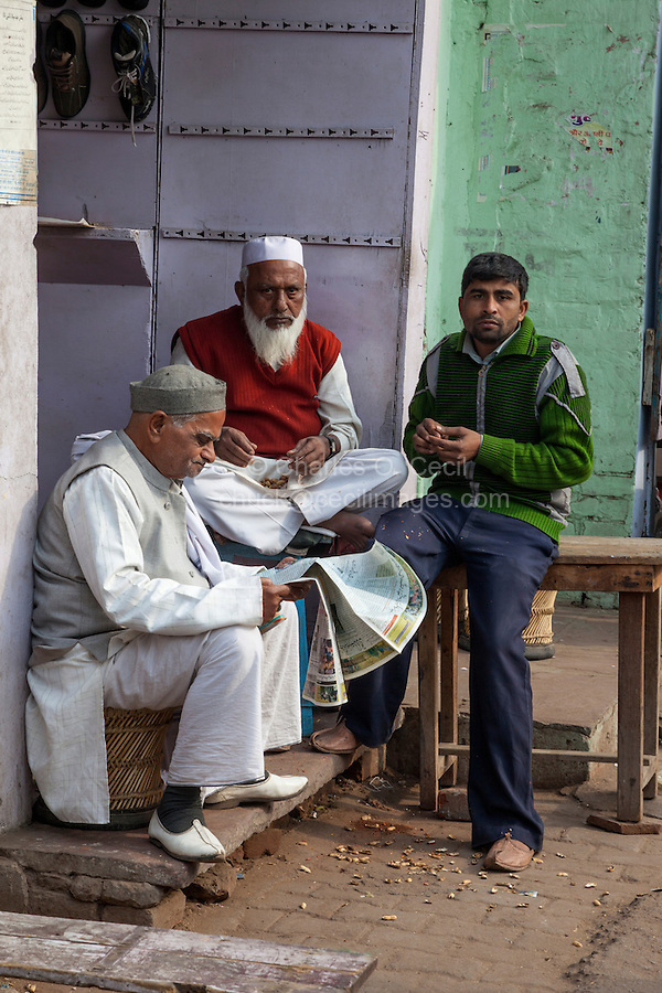 Agra, India.  The Old Generation and the New--Eating Peanuts While Conversing.