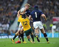 Jonny Gray of Scotland is tackled by Matt Giteau of Australia during the Quarter Final of the Rugby World Cup 2015 between Australia and Scotland - 18/10/2015 - Twickenham Stadium, London<br /> Mandatory Credit: Rob Munro/Stewart Communications